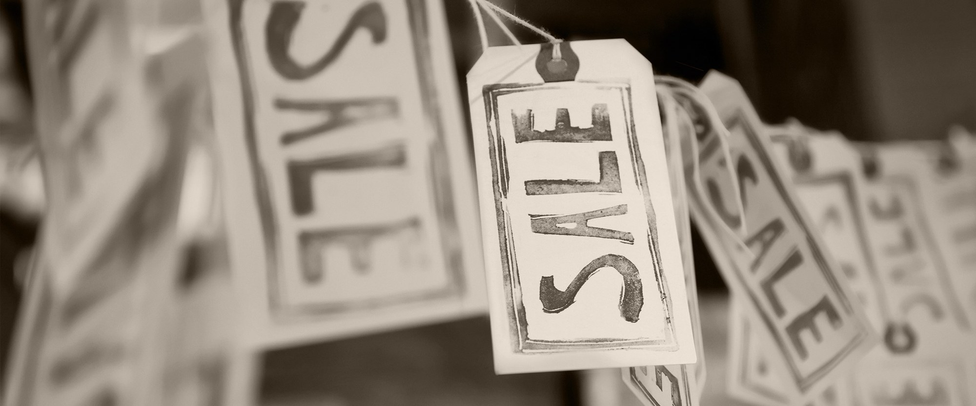 sale tags hanging on a string