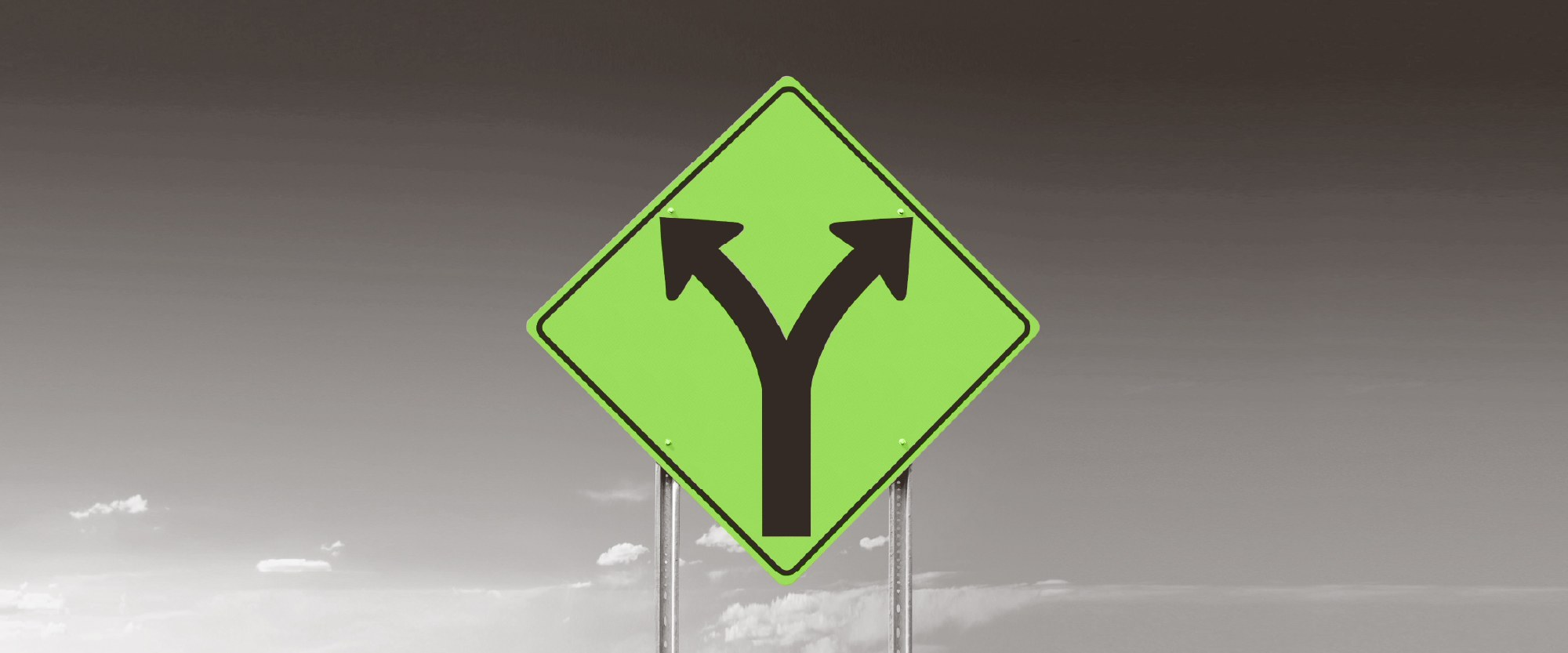 green road sign with 2 options to turn right or left